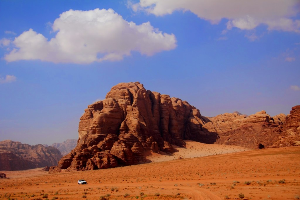 Sandy terrain and grandeur of the rocks at Wadi Rum