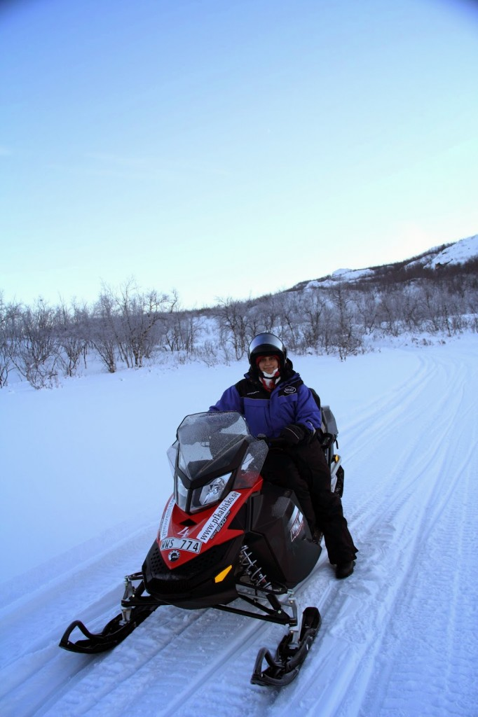 Riding a snow mobile on the frozen river