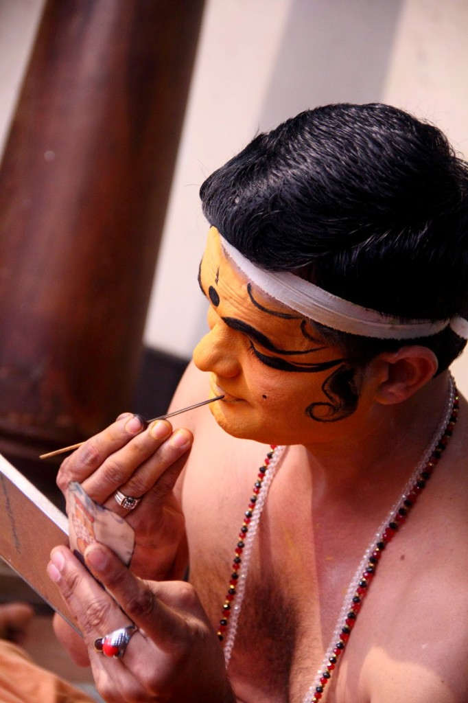 Kerala: Kathakali make up in progress, application of the base colour