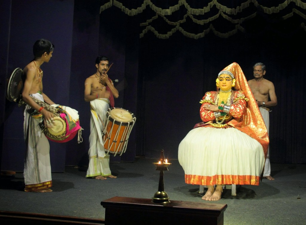 Kerala: Kathakali dancer with the percussion instruments and vocalist (behind the dancer)