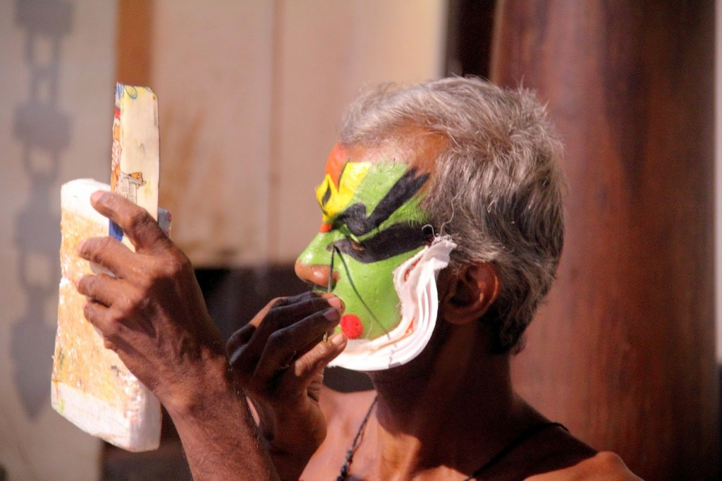 Kerala: Kathakali dancer applying finishing touches to his make up