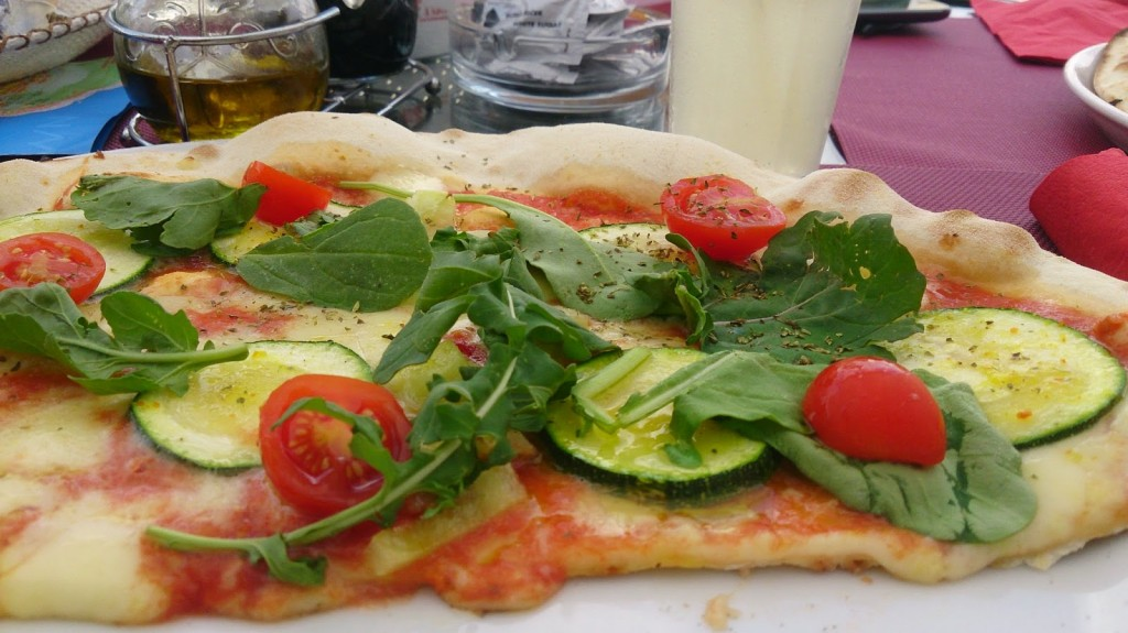Vegetable pizza with fresh rocket leaves