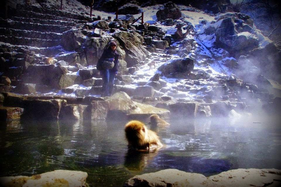 Hot spring with man and 'pre-historic man'