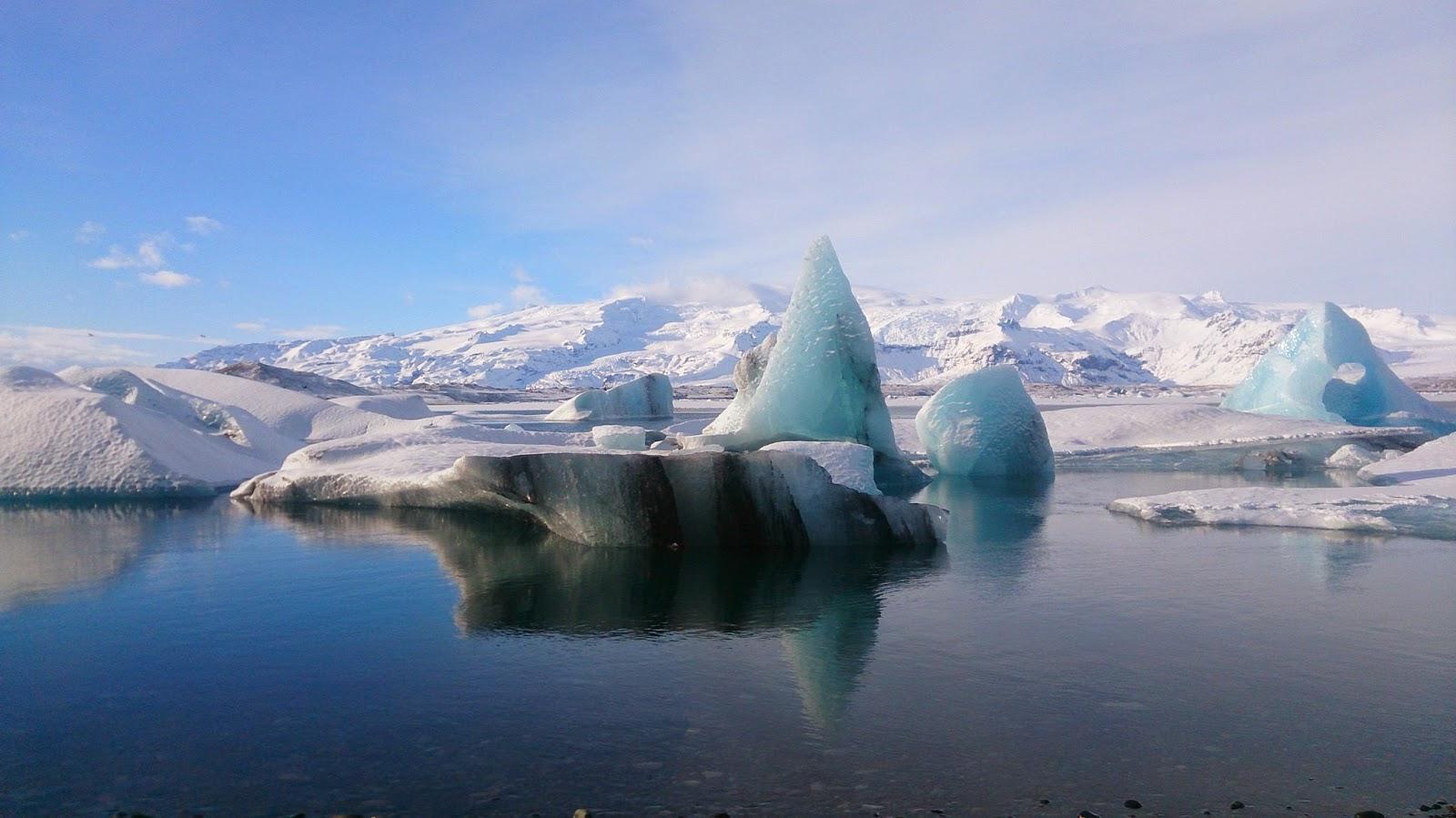 Masses of blue glacial ice floating at Jokulsarlon glacial lagoon