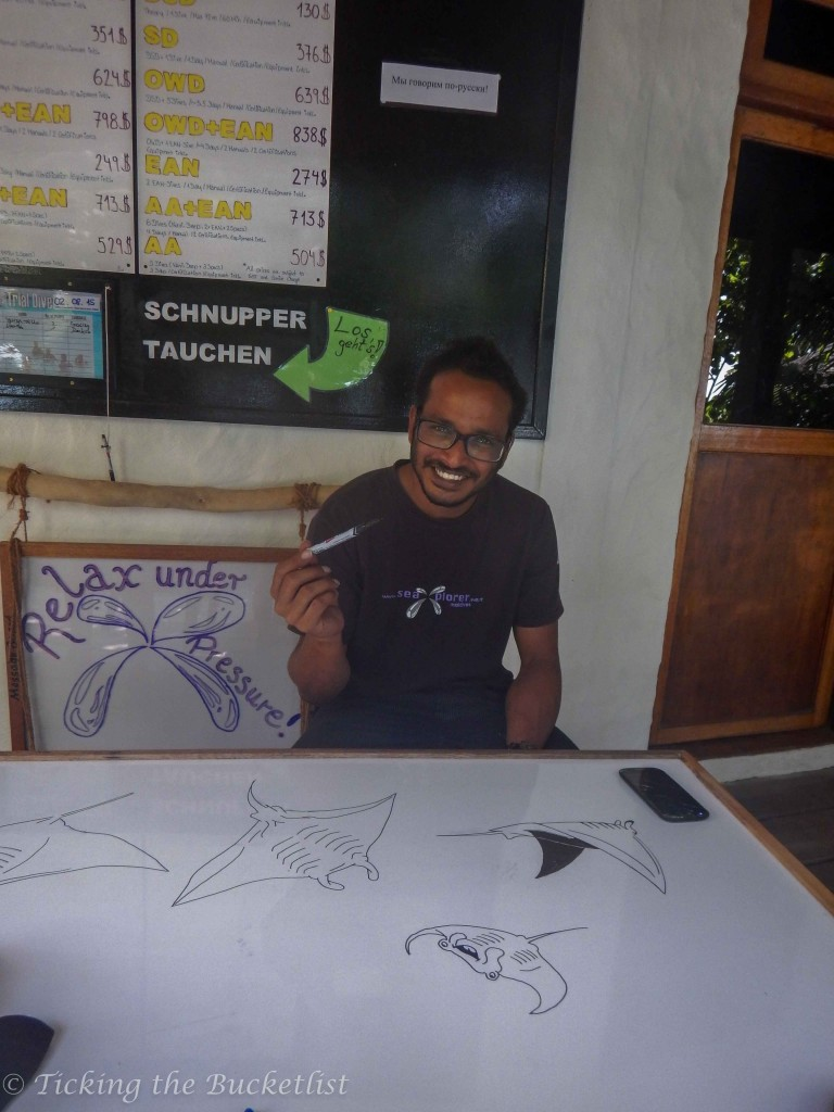 Mohan, doodling manta rays on the white board