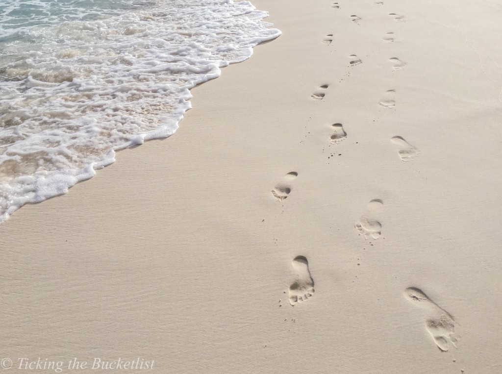 Walking on the pristine Grande Anse sands