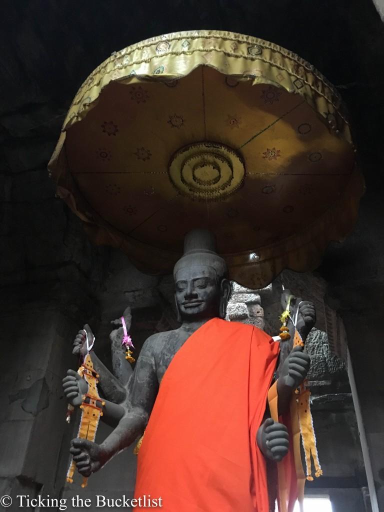 Vishnu, who now bears the head of a Buddha